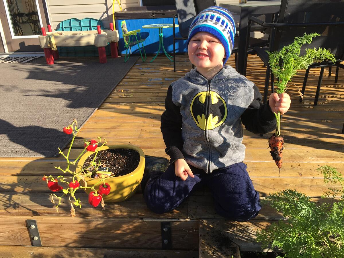 Gardening blog - son with carrot